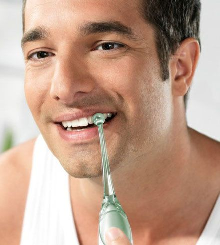 beneficios de usar un irrigador dental