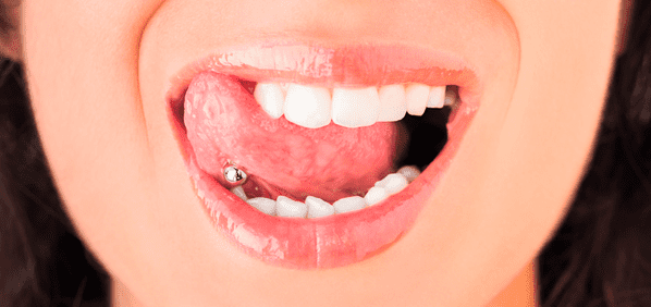 piercing causa lengua marron